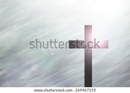The Christ Cross On Motion Blur Background With Lighting Lens Flare - stock photo