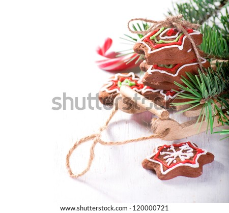 The Christmas background with sled and gingerbread biscuits