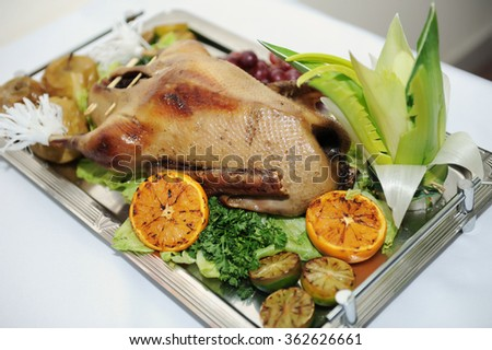 the Christmas baked goose with oranges. vintage style. selective focus - stock photo