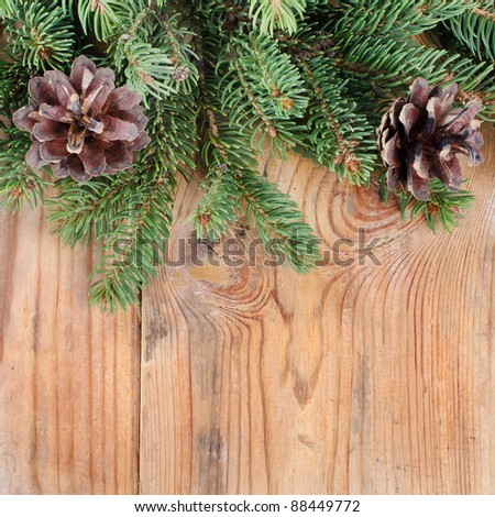 The christmas decorative border on wooden background