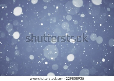 the christmas snowfall in the evening, natural photography of bokeh background - stock photo