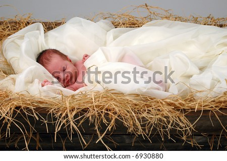 The Christmas story with baby Jesus sleeping in manger