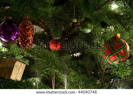 The Christmas tree is a decorated evergreen coniferous tree, real or artificial, and a popular tradition associated with the celebration of Christmas. - stock photo