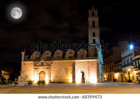 The Church and Square of San Francisco in Havana at night with a bright full moon - stock photo