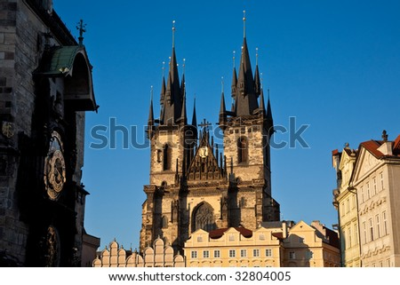 The Church of Our Lady before Tyn, Prague, with the Astronomical Clock in the foreground. - stock photo