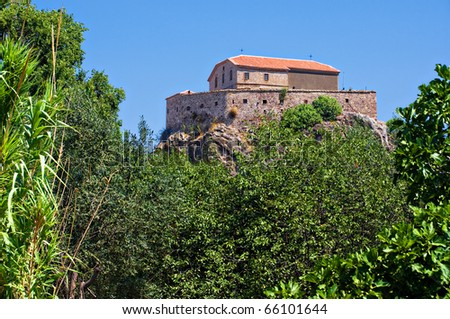 the church of Our Lady of the Sweet Kiss sits atop a rock outcrop above the town of Petra, Lesvos