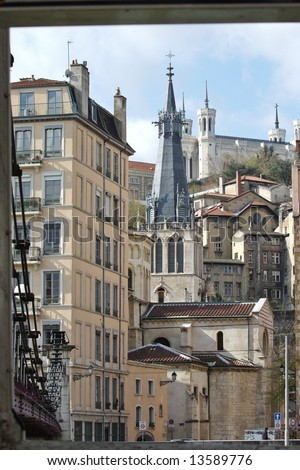 The church of Saint Vincent was built in the second half of the 18th century. The façade of the church was added at the end of the 19th century. Fourviere basilica is on the top hill - stock photo