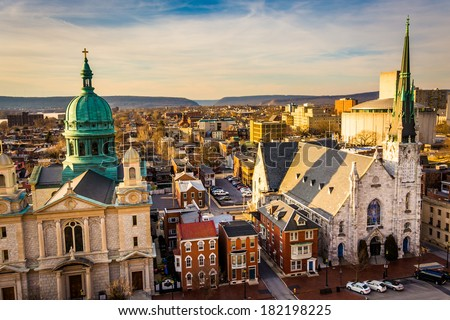 The churches and neighborhoods seen from the South Street Parking Garage in Harrisburg, Pennsylvania. - stock photo