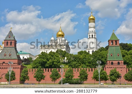 The Churches Of The Moscow Kremlin. View of the Moscow Kremlin from the Moscow river in the early summer. - stock photo