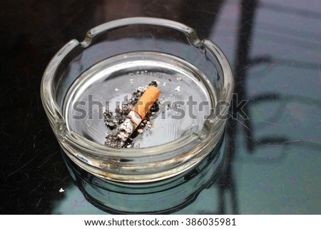 the cigarette stubs in the ashtray . blur view - stock photo