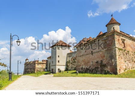 The Citadel of Brasov, Romania, starting from 1981, after consistent restoration, became a touristic complex with medieval peculiarity. - stock photo