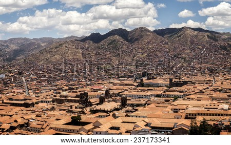 The city Cusco in Peru, surrounded by mountains - stock photo