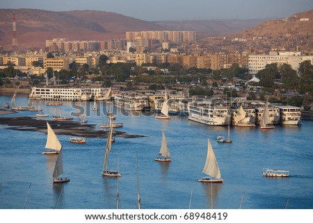 The city of Aswan with felucca boats on the Nile river