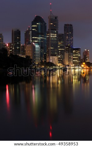 The City of Brisbane reflected in the Brisbane River including Riparian Plaza, the Australian city's icon.