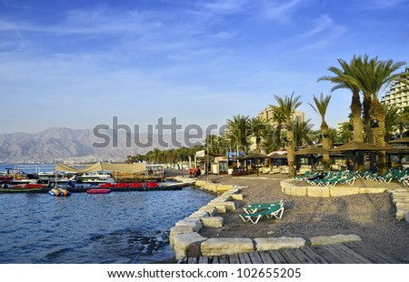 The city of Eilat has become the ultimate resort city with beautiful marine beaches and resort hotels packed with relaxing tourists from around the world - stock photo