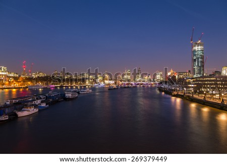 The City of London Skyline at Dusk showing boats, buildings and construction. There is copy space in the image.