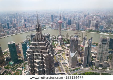 The cityscape of Shanghai with the Jin Mao Tower in the foreground. - stock photo
