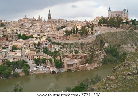 The cityscape of the old Toledo, Spain, including Alcazar and Cathedral - stock photo