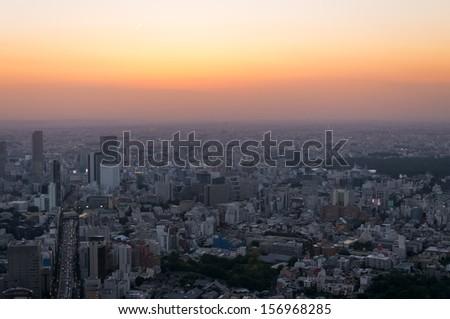 The cityscape of Tokyo at sunset, looking towards Shinjuku. - stock photo