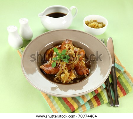 The classic English meal of bangers and mash with gravy ready to serve. - stock photo