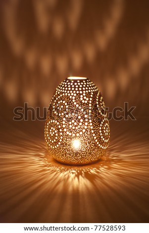 the clay pot is shone from within - stock photo