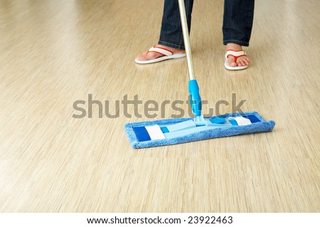 The cleaner washes a floor in premises - stock photo