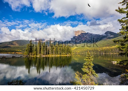 The clear autumn morning in Jasper National Park, Canada. Charming little island in the Pyramid Lake - stock photo