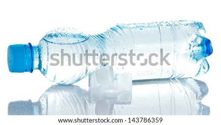 The cleared drinking water in a plastic bottle, and the cubes of ice isolated on white