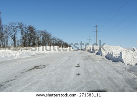 the cleared road after snowstorm - stock photo