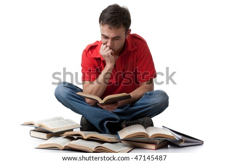 The clever young man  sitting with books on a white background. - stock photo