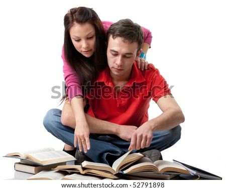 The clever young people  sitting with books on a white background. - stock photo