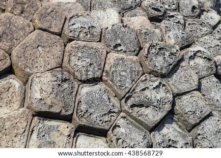 The Cliff of Stone Plates Da Dia (Ghenh Da Dia) in Central Vietnam, seashore area of uniformly interlocking basalt rock columns, created from volcanic eruptions millions of years ago - stock photo