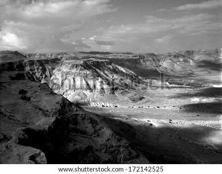 The cliffs in the Negev Desert taken from the ancient fortress of Masada. - stock photo