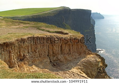 The Cliffs of Moher (Ireland) on a day of mist - stock photo