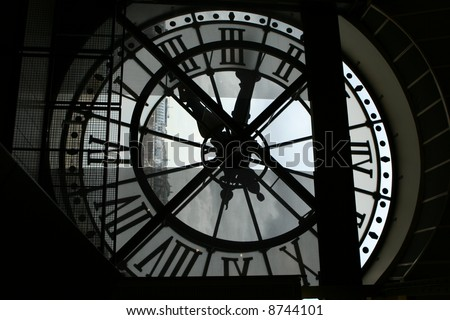 The clock looking out from Musee d'Orsay - stock photo
