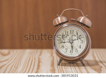 The clock on the table,selective focus - stock photo