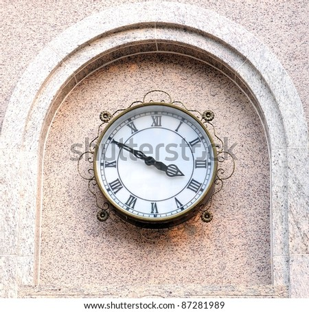The clock on the wall - stock photo