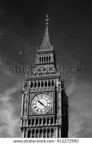 The Clock Tower in London, half Moon on its left, black and white photography, in England, UK - stock photo
