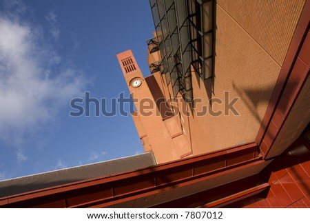 The clock tower of the British Library adjacent to St Pancras International Station in London. - stock photo