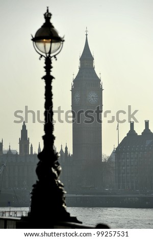 The Clock Tower of the Palace of Westminster London with Embankment light in foreground.