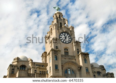 The clock tower of the Royal Liver Building a Liverpool, UK landmark - stock photo