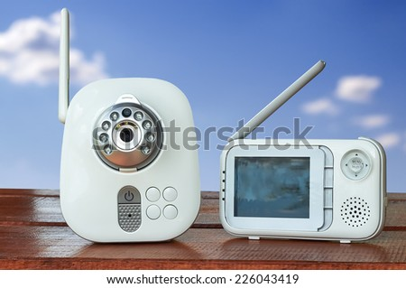 The close-up baby monitor for security of the baby . Blue sky behind