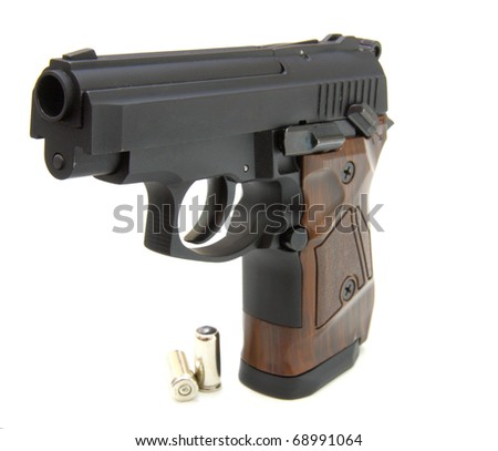The close up of a pistol a target and cartridges is isolated on a white background - stock photo