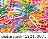 the close up of colorful clips on white background - stock photo