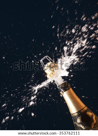 The close up of explosion of champagne, is a lot of splashes
