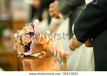 The close up of wedding bouquet at church on wedding day - stock photo