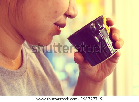 The close up of woman is going to drink the water in vintage style, concept of healthy life. Selective focus  - stock photo