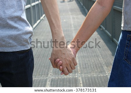 The close up shot of couple hands holding together, concept of love, family, dating