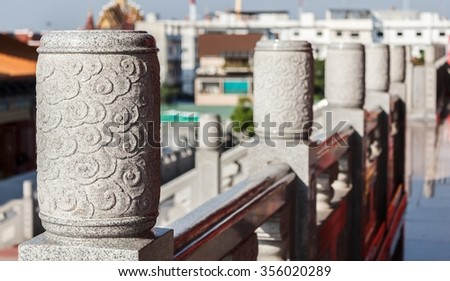 The close up view of stone carved handrail at Chinese temple - stock photo