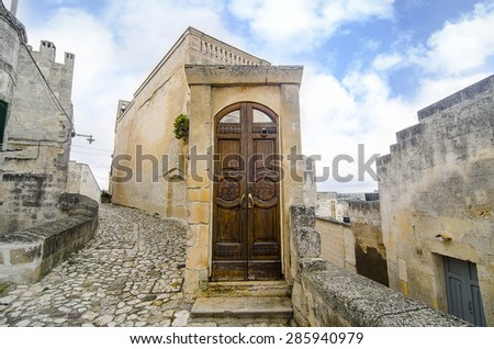 The close up view of wood entry door. Ancient town of Matera's church (Sassi di Matera),  Basilicata, southern Italy. European Capital of Culture for 2019. UNESCO World Heritage.  - stock photo